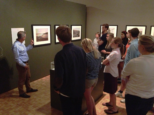 Students looking at photos in exhibit