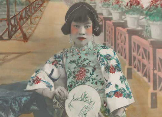 This hand-colored portrait shows an actress in traditional Chinese theater costume.