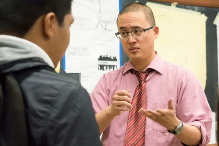 Teacher David Ko instructs an ethnic studies class at Washington High School in San Francisco. A Stanford study found students benefit from such courses. Here, Ko is explaining an assignment about the role of advertising in reinforcing cultural stereotype
