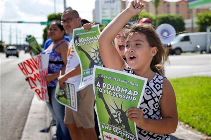 Immigration activists in Miami in August 2013 call for a route to citizenship for undocumented individuals as immigration debate heats up in Congress.