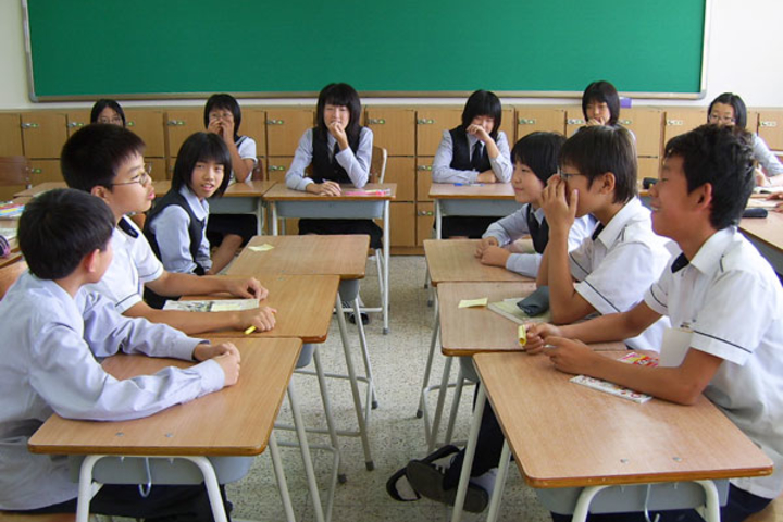 In South Korea, students take moral education courses that teach values including cooperation.
