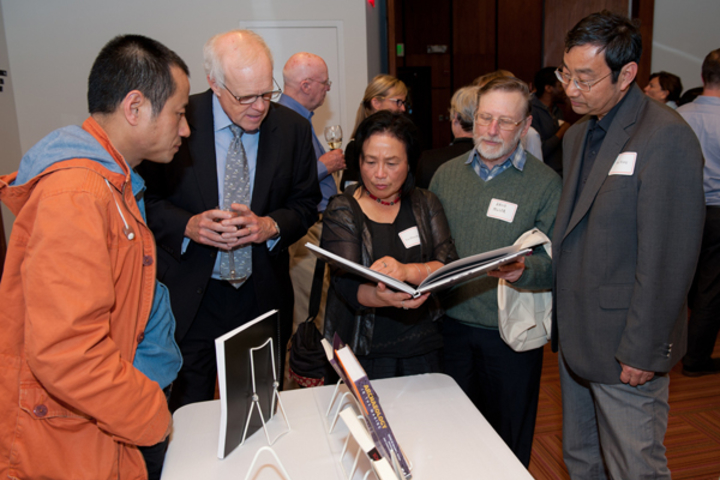President John Hennessy commended Stanford authors for their remarkable achievements, while visual interpretations of data about the works illustrated their impressive scope.