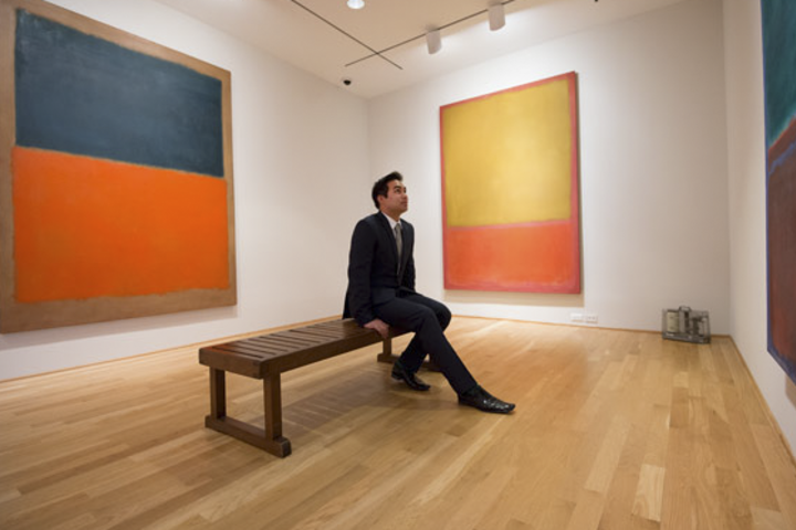 Brady Magaoay uses a break to study the paintings in the Rothko room at the Phillips Collection.