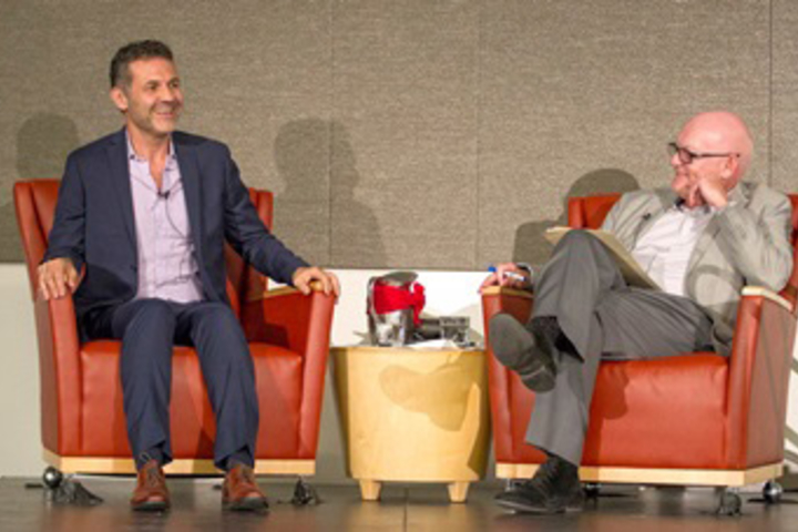 Author Khaled Hosseini is interviewed by Paul Costello, chief communications officer for Stanford School of Medicine.