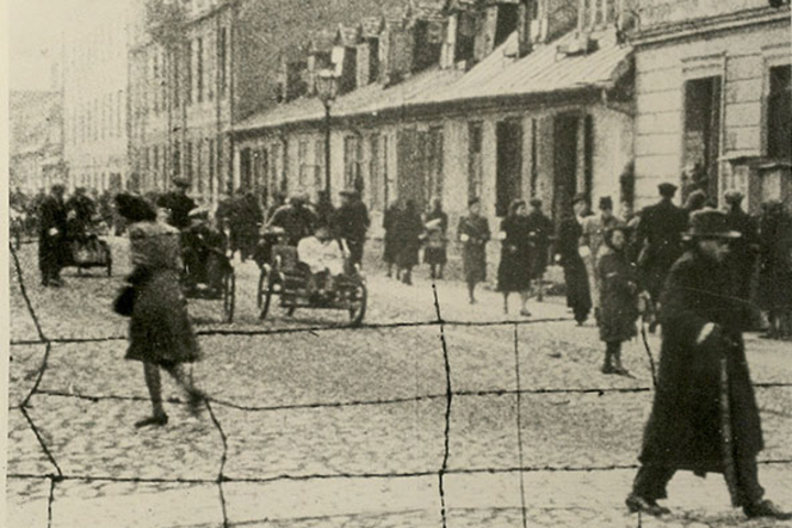 A barbed wire fence surrounds the Warsaw Ghetto in this photo from the Jan Karski collection at the Hoover Archives.