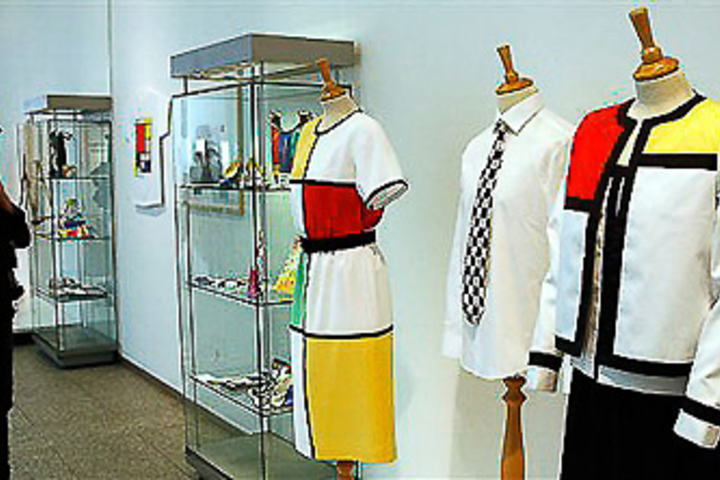 Woman looking at dresses with Mondrian prints on them.