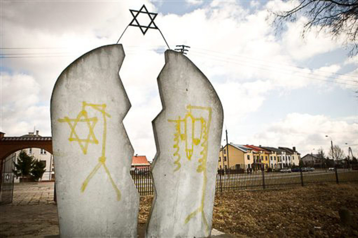 A memorial plaque stained with anti-Semitic vandalism in Mazowieckie, Poland, March 19, 2012. This incident and other more recent ones reflect an increase in anti-Semitism in Europe.