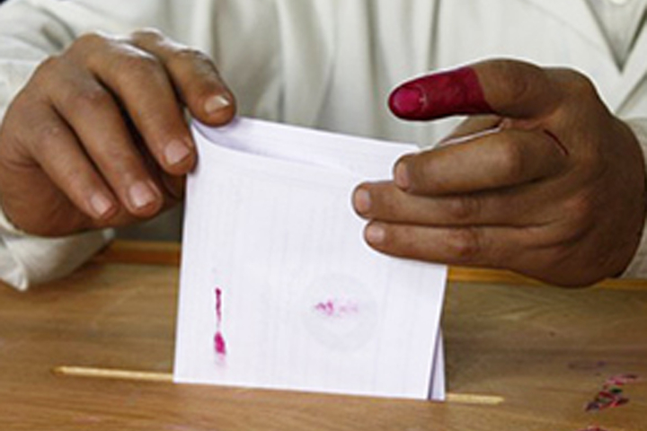 Image of man casting a vote in the Middle East