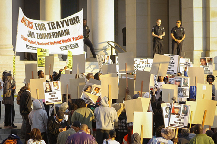 Marchers carry signs in support of Trayvon Martin and other victims of violence at Los Angeles City Hall in April 2012.