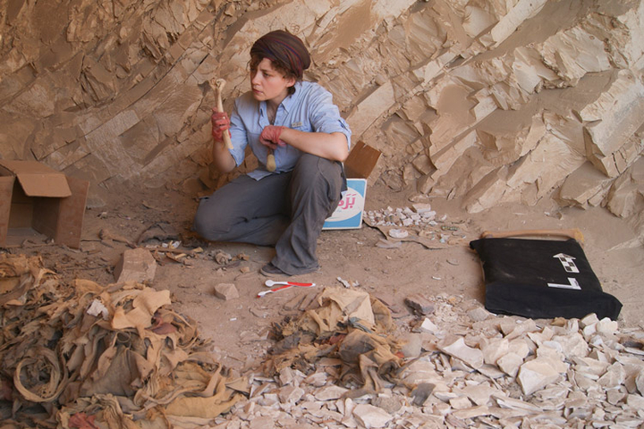 Stanford postdoctoral scholar Anne Austin examines the skeletal remains of ancient Egyptians found in the burial sites of Deir el-Medina.