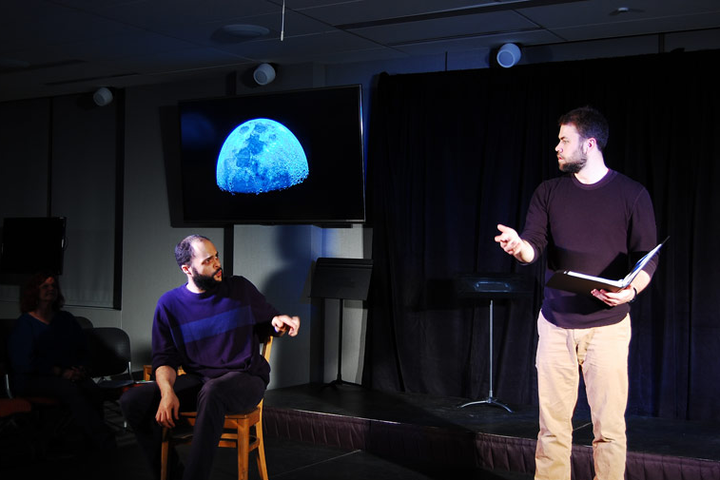 Galileo, played by TAPS grad student Alex Johnson, discusses the moon, as seen through his telescope, with his mathematician friend Sagredo, played by professional actor Chris Carter.