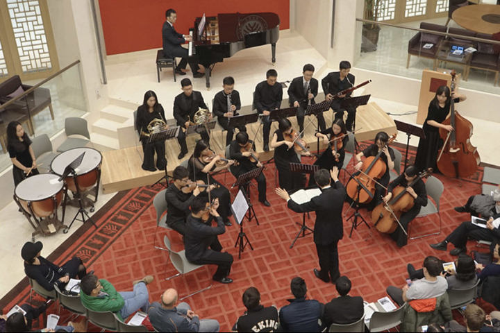 At the Stanford Center in Peking University, Stanford Associate Professor Jindong Cai conducts a re-creation of the first performance, in 1922, of a Beethoven symphony by an all-Chinese ensemble of 15 musicians.