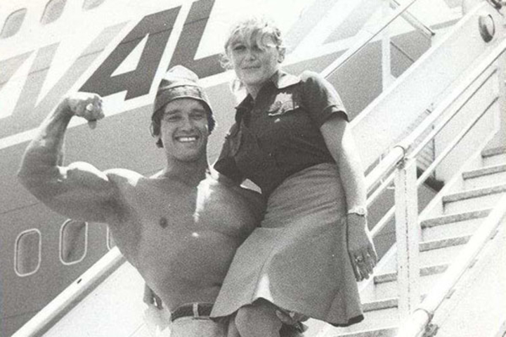 Arnold Schwarzenegger posing by airplane in Israel