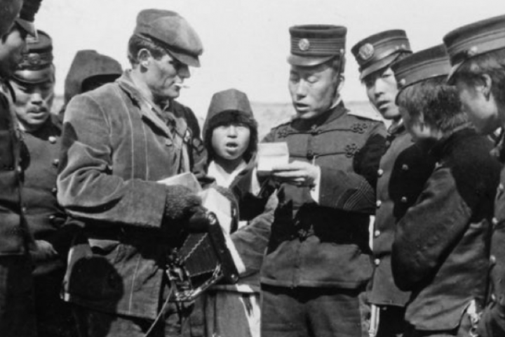 Jack London, center left, negotiates passage with a Japanese officer in Korea during the Russo-Japanese War of 1904-05. Renowned as a writer, London's photojournalism has often been overlooked.