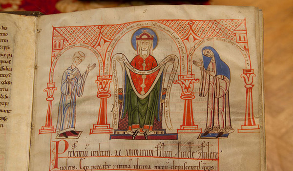 Photo of medieval text showing a female scribe and male artist.