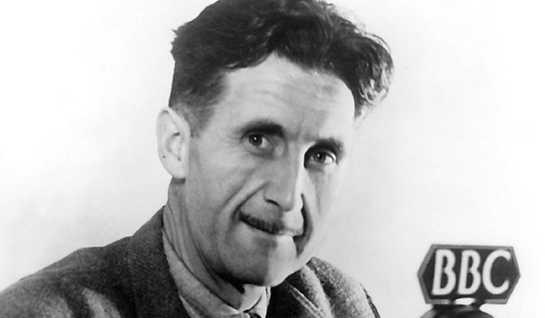 Photo of writer George Orwell holding a microphone